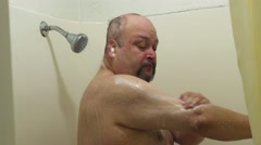 Man Soaping Up in Shower Stock Footage