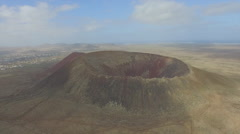 AERIAL: Majestic extinct volcano in the middle of volcanic island Stock Footage