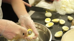 Boiled eggs cut and scoop Stock Footage