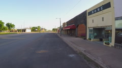 Driving By Storefronts In Farm Town Square Of Crowell Texas Stock Footage