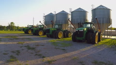 Driving By Row Of New Tractors And Grain Bins- Crowell Texas - stock footage