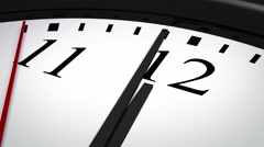 Close-up of a clock striking twelve Stock Footage