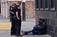 SFPD officers interrogating black american men in San Francisco Stock Photos