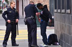SFPD officers patdown black american man in San Francisco - stock photo