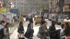 People in NYC crossing busy street with traffic going by Stock Footage