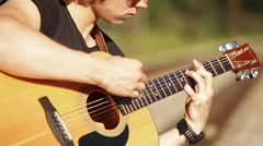 Acoustic Guitar long haired blond player Stock Footage