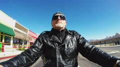 Helmetless Biker Low Angle Riding Shot- Small Arizona Town Stock Footage