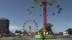 Three Rides Running At Same Time - stock footage