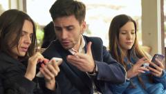 Young friends with smartphone fighting, arguing in cafe in city HD Stock Footage