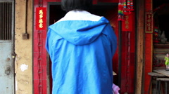 Small street side Chinese shrine in Macau - stock footage