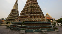 Pan of Spires / Stupa at Wat Pho Temple in Thailand Stock Footage