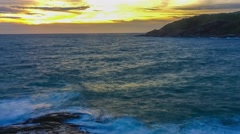 Time Lapse: At sunset, the waves crashing on the rocks Stock Footage