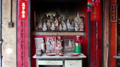 Altar of small street side Chinese shrine in Macau Stock Footage