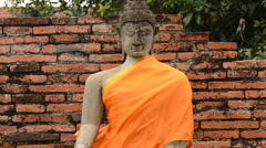 Zoom Out - Dressed Statue of Buddha at Temple - stock footage