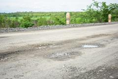 Rough bumpy stone road in rural Stock Photos