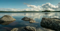 Stock Video Footage of summer mood at lake with small island, lake Jetningen near Gålå, timelapse