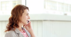 Smiling woman calling with her smartphone Stock Footage