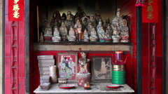 Altar of small street side Chinese shrine in Macau - stock footage