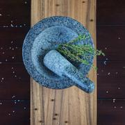 Stone mortar and herbs - stock photo
