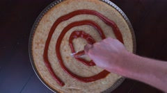 Time lapse of rustic home made pizza with hands placing ingredients Stock Footage