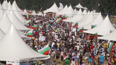 Bulgarian festival with many peoples and tents in slow motion Stock Footage