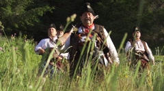 Bulgarien in old clothes and with guns came down from the mountain Stock Footage
