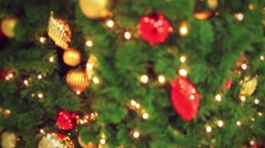 Christmas decoration- hanging lanterns with holly twigs on tree. decorations Stock Footage