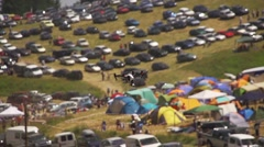 Quadrocopter with video camera flieswith background cars and camping Stock Footage