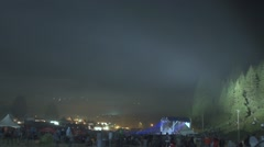Many peoples move quickly on festival in the mountains with fog and night Stock Footage