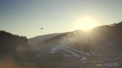Military aircraft flew on  sunset time over festival in the mountain Stock Footage