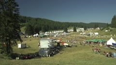 Peoples move quickly on festival in the mountains Stock Footage