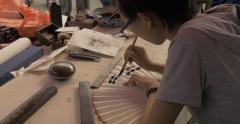 4K Calligrapher Writes on Paper Fan Stock Footage