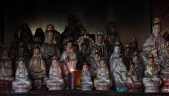Old Chinese porcelain figurines of Guan Shi Yin Bodhisattva Stock Footage