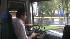 Bus driver driving in a city Stock Footage