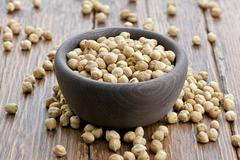 Bowl with raw chickpeas - stock photo