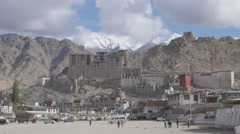 Leh royal palace and parking lot, snow capped mountains,Leh,Ladakh,India Stock Footage