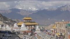 Leh gate with chorten,shops and traffic,Leh,Ladakh,India Stock Footage