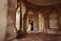 Bride and groom surrounded by beautiful architecture Stock Photos