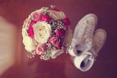 Top view of wedding bouquet with white gumshoes - stock photo