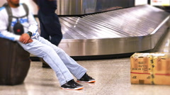Man Waiting For Bags at Baggage Claim, 4K Stock Footage