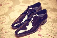 Elegant leather grooms shoes - stock photo
