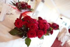 Red bouquet for wedding table Stock Photos