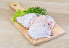 Raw chicken thighs Stock Photos