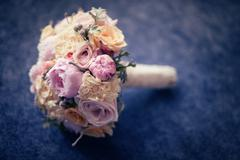 Beautiful wedding bouquet with many flowers - stock photo