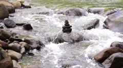 Stock Video Footage of Flowing small stream with Zen stone