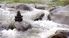 Flowing small stream with Zen stone - stock footage