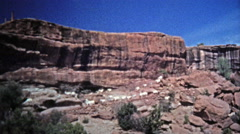 1972: Mountain goats freely roaming the dangerous cliffs edges. Stock Footage