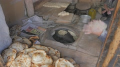 Tandoori bread bakery with clay oven,Leh,Ladakh,India Stock Footage