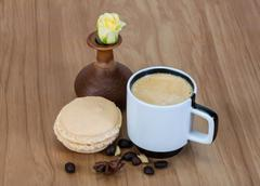 Coffee with macaroons and rose - stock photo