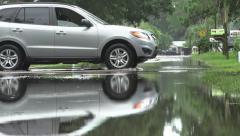 SUV Drives Thru Flooded Street In Florida Residential Neighborhood Stock Footage